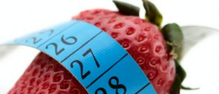 Strawberry with measuring tape